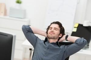 Businessman Taking A Break At His Desk